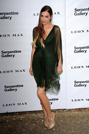 Amber Le Bon matched her green dress with an elegant pair of nude cutout boots at the Serpentine Gallery summer party.