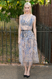 Poppy Delevingne flashed her black undies in a sheer, patterned cocktail dress by Christopher Kane during the Serpentine Gallery Summer Party.