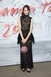 Stacy Martin polished off her look with a beaded flower purse by Chanel.