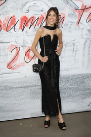 Alexa Chung complemented her dress with black peep-toe mules by Christian Louboutin.