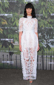 Erin O'Connor was a head turner in a see-through white lace dress during the Serpentine Summer Party.