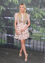 Laura Whitmore was cute and girly at the Serpentine Summer Party in a printed mini dress with swirly gold embroidery.
