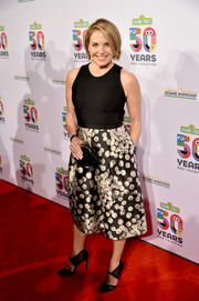 Katie Couric donned a cocktail dress with a black bodice and a printed skirt for the Sesame Workshop 50th anniversary benefit gala.
