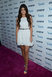 Kylie looked romantic with her lacy white dress and mermaid tresses.