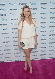 Greer Grammar looked right on-trend in this white silk romper with shoulder cutouts.