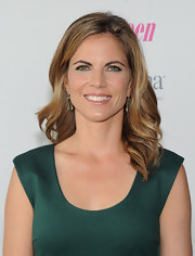 Natalie Morales showed off her dirty blonde hair with a soft, loose wave.