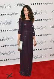 Andie MacDowell sparkled on the red carpet of the Women of Worth Awards in this aubergine 3/4 sleeve gown.