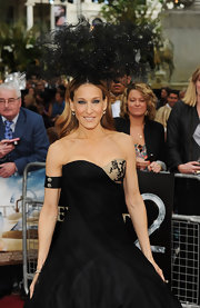 Sarah Jessica Parker completed her Alexander McQueen dress with 19th century diamond cluster ear clips, worn on a ribbon arm cuff.