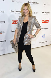 Kim Fisher paired her sequin blazer with black leggings and tunic top.