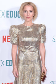 Gillian Anderson attended the world premiere of 'Sex Education' season 2 carrying a gold box clutch to match her dress.