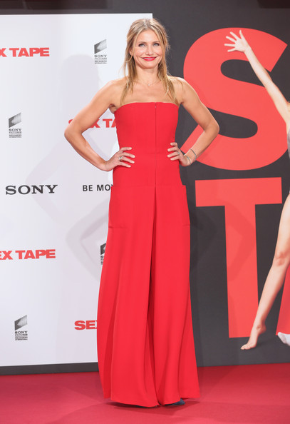 Cameron Diaz looked sassy in a strapless red jumpsuit by Christian Dior at the 'Sex Tape' premiere in Germany.