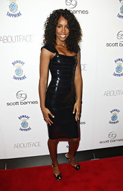 Former Destiny's Child member Kelly Rowland showed off her curly mid-length bob at an event. We love how her curls bounce!