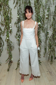 Michelle Monaghan looked adorable in a scalloped white jumpsuit at the Shani Darden Studio opening.