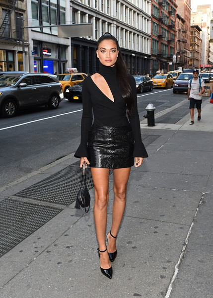 Shanina Shaik sealed off her look with black ankle-strap pumps.
