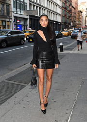 Shanina Shaik amped up the sex appeal with a black leather mini skirt.