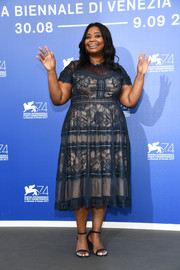 Octavia Spencer kept it ladylike in a blue lace midi dress by Tadashi Shoji at the Venice Film Festival photocall for 'The Shape of Water.'