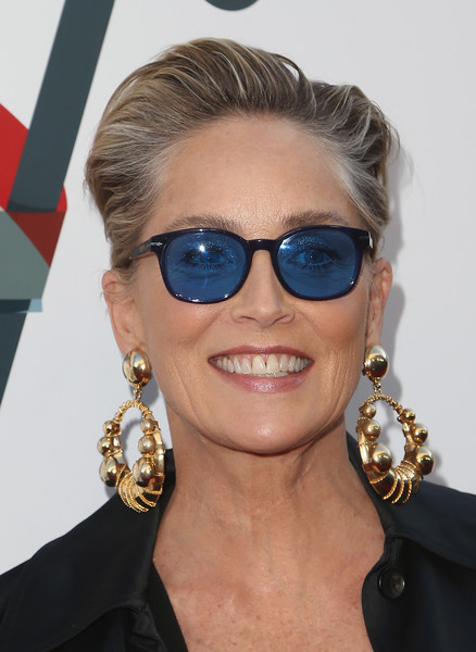 Sharon Stone Gold Hoops [film,image,eyewear,sunglasses,vision care,hairstyle,eyebrow,chin,fashion,fashion model,jewellery,glasses,steven tyler,sharon stone,hairstyle,hair,eyewear,sunglasses,live nation,inaugural janies fundgala grammy viewing party,sharon stone,basic instinct,actor,beverly hills,golden globe award,film,hairstyle,image,short hair]