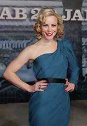 Rachel McAdams perfectly paired her ravishing red lips with gothic glam nail polish in a dark shade of red.