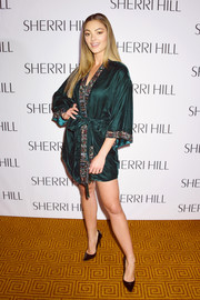 Demi-Leigh Nel-Peters posed backstage at the Sherri Hill fashion show wearing an emerald-green robe.