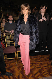 Lisa Rinna teamed her coat with pink wide-leg pants and a black blouse.