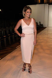 Candace Cameron Bure attended the Sherri Hill fashion show wearing a cream-colored V-neck crop-top.