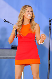 Sheryl rocked out on stage in a color blocked dress which she topped off with white bangle bracelets.