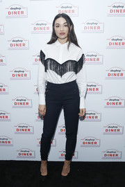 Crystal Reed paired her shirt with black skinny pants.