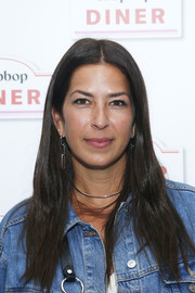 Rebecca Minkoff sported a loose center-parted hairstyle at the Shopbop Diner.