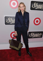 Leelee Sobieski was business-chic in a navy cropped jacket layered over a jumpsuit.