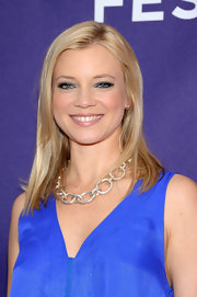 Amy Smart was all smiles on the red carpet at the Tribeca Film Festival. She softly parted her straight locks down the center for a sleek finish.