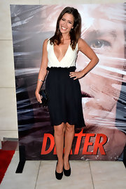 Mercedes wore this black and white V-neck dress to the celebration of eight season of 'Dexter.'