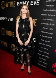 Kerris Dorsey looked youthful and pretty wearing this black and gold leaf-embroidered dress at the Showtime Emmy eve party.