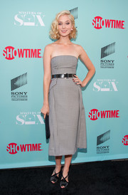 Caitlin Fitzgerald paired her stylish dress with strappy black satin peep-toes by Jimmy Choo.