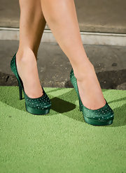 Amanda Holden dazzled in emerald satin platform pumps with rhinestone accents at the press night for 'Shrek - The Musical.'
