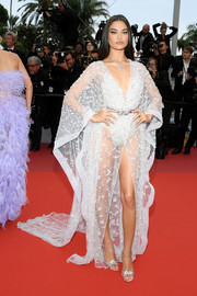 Shanina Shaik sent temperatures rising in s sheer, beaded robe dress by Zuhair Murad Couture at the 2019 Cannes Film Festival screening of 'Sibyl.'