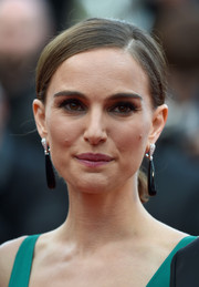 Natalie Portman went for fuss-free styling with this side-parted chignon at the 'Sicario' premiere in Cannes.