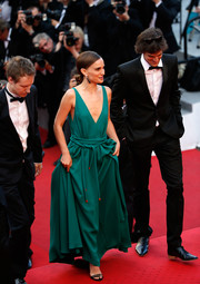 Natalie Portman donned a plunging green Lanvin gown with a layered belt for the 'Sicario' premiere in Cannes.