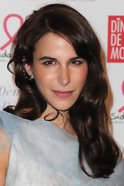 Caroline Sieber wore her bangs swept to the side and her longer locks in shiny waves at the 2012 Sidaction Gala Dinner.