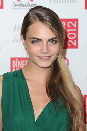 Cara Delevingne wore her tresses in a low ponytail at the Sidaction Gala Dinner 2012.