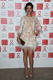 Melanie was feathered and flirty in this white velvet burnout cocktail dress at the Sidaction Gala Dinner.