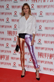 Constance Jablonski balanced out her colorful pants with a basic white button-down.