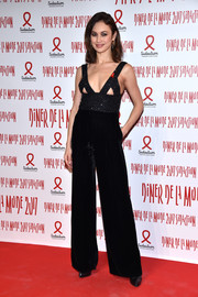Olga Kurylenko sizzled at the 2017 Sidaction Gala in a dual-textured black Armani jumpsuit featuring bust cutouts.