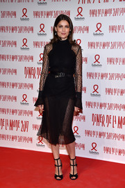 Laetitia Casta kept it chic all the way down to her black gladiator heels.