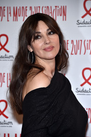 Monica Bellucci stuck to her usual long hairstyle with parted bangs when she attended the 2017 Sidaction Gala.
