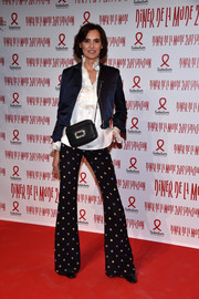 Ines de la Fressange attended the 2017 Sidaction Gala wearing a cropped satin jacket over a ruffle blouse.