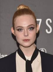 Elle Fanning slicked her hair back into a high bun for the Sundance premiere of 'Sidney Hall.'