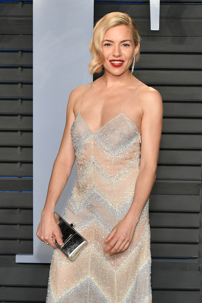 Sienna Miller Metallic Clutch [oscar party,vanity fair,clothing,dress,cocktail dress,shoulder,fashion model,gown,fashion,lady,strapless dress,beauty,beverly hills,california,wallis annenberg center for the performing arts,radhika jones - arrivals,radhika jones,sienna miller]