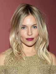 Sienna Miller's raspberry liptick worked beautifully with her gold frock.