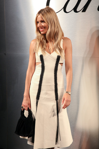 Sienna Miller Velvet Bag [cartier celebrates the launch of santos de cartier watch,white,fashion model,clothing,dress,fashion,cocktail dress,beauty,hairstyle,fashion show,black-and-white,arrivals,sienna miller,red carpet,california,san francisco,pier 48,santos de cartier watch launch]