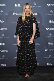 Sienna Miller was boho-glam in a Sonia Rykiel printed maxi dress with cape detail at the International Medical Corps summer cocktail event.